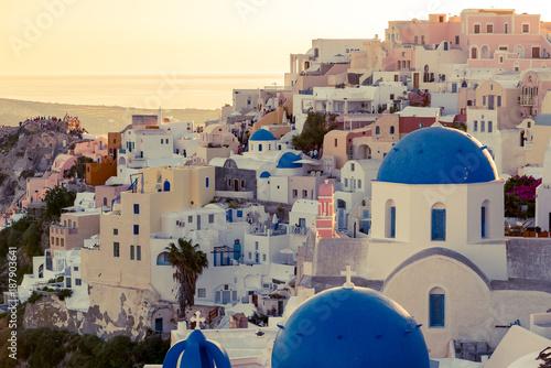 Fototapeta Oia, Santorini - Greece. cityscape of oia, traditional greek village of Santorini, with blue domes of Churches at Sunset. obraz