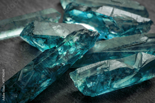 Aquamarines  and raw crystal gems concept with closeup of a bunch of blue uncut Canvas Print