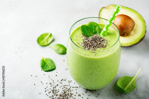 Vegetarian healthy green smoothie from avocado, spinach leaves, apple and chia seeds on gray concrete background Fototapete