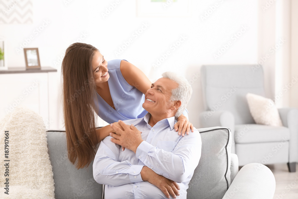Fototapety, obrazy: Mature man with daughter in comfortable room