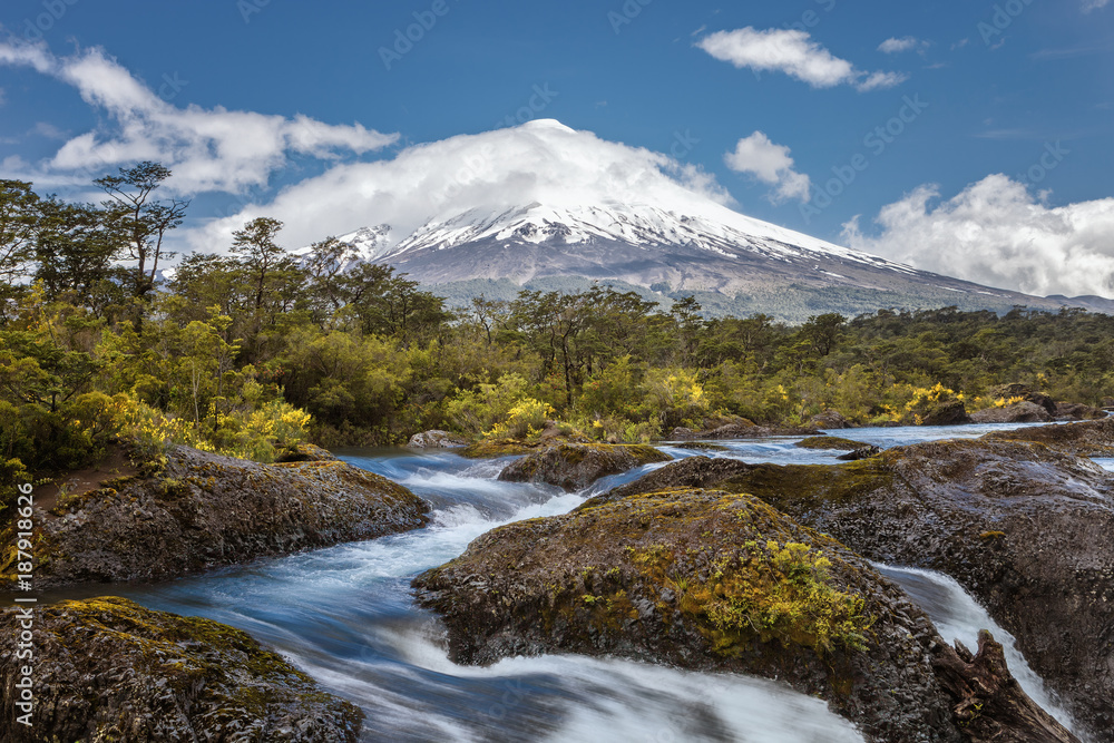 Landscape of the Osorno volcano with the Petrohue waterfalls and river in the foreground in the lake district near Puerto Varas and Puerto Montt, Chile.