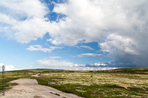 Poster Poolcirkel Dirt road in tundra in the north of Russia
