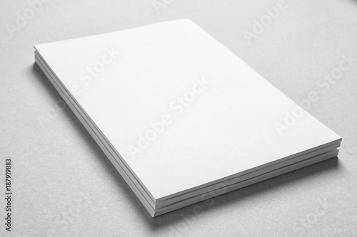 Fotografía  Blank sheets of paper on light background. Mock up for design