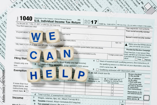 Obraz na plátne Macro close up of 2017 IRS form 1040 with WE CAN HELP letters