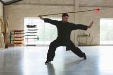 Kung Fu Fighter Practicing Wit...