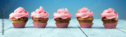Tasty cupcakes on wooden background Canvas Print