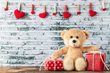Fototapeta Child room - Teddy bear sitting with gift box