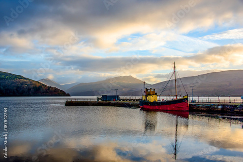 Loch Fyne with pier and boat in Inveraray, Scotland Wallpaper Mural