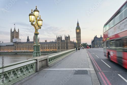 Poster Londen rode bus Red bus speeding up along Westminster Bridge at sunset, London - UK