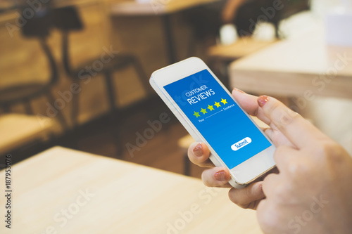 Fotografía  Customer review rating business concept, Woman hand using mobile phone