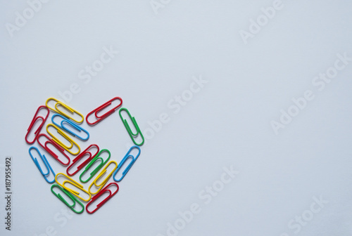Fotografía  Multicolored heart out of paperclips isolated on white background with text space
