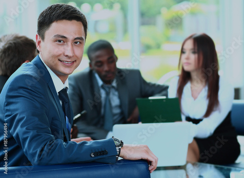 Fototapety, obrazy: Confident young business man attending a meeting with his colleagues.