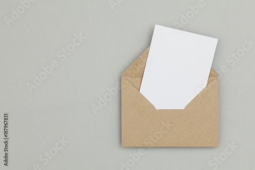 Fototapeta Blank white card with kraft brown paper envelope template mock up obraz