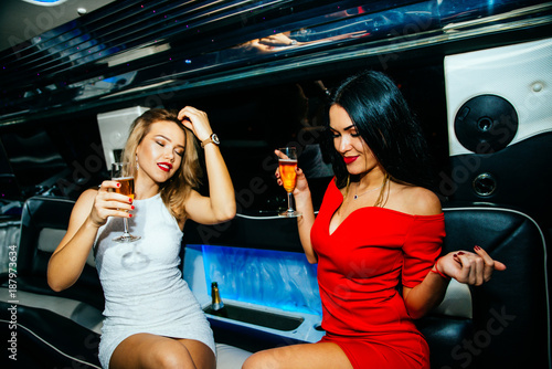 Beautiful girls making party in the limousine Wallpaper Mural