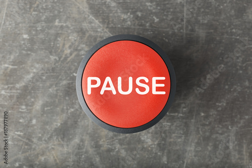 Photo Overhead of Red Pause Push Button on Concrete Background