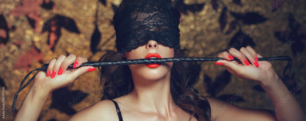 Fototapeta Sexy woman in blindfold bite whip with red lips banner