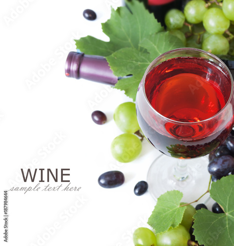 glass of wine, grapes and bottle isolated on white background