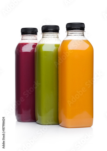 Bottles of healthy fruit juice smoothie