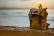 Hipster hiker tourist yellow backpack closeup on background blue sea enjoying sunset ocean horizon, seascape sunrise blank mockup, traveler relax holiday concept, sunlight view in trip vacation