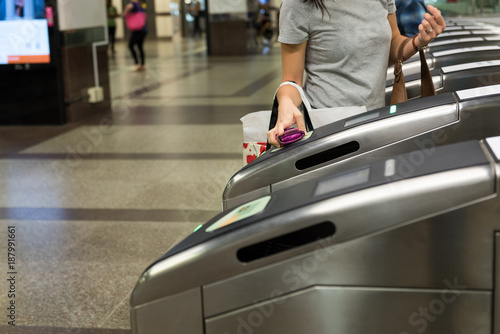 Photo  Woman Passenger use ticket passing the entrance at Orchard MRT station