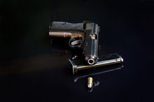 Handgun On Black Reflective Ba...
