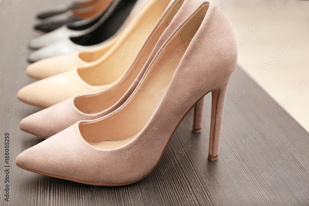 Fototapety, obrazy: Elegant beige shoes on wooden shelf, closeup