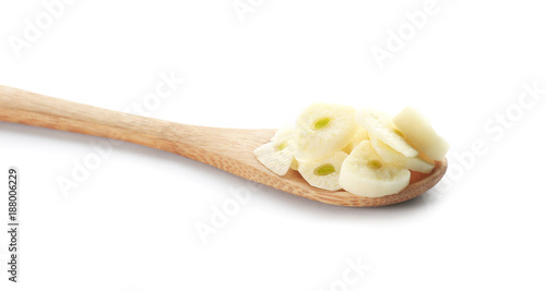 Photo Stands Herbs 2 Wooden spoon with chopped garlic on white background