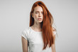 Beautiful ginger young redhead female of European appearance posing indoors