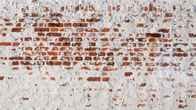 Texture Of Old Brick Wall With Peeling Plaster. Beautiful Background Of Old Brickwork Of The Historic Building.