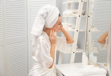 Young Woman With Towel Looking...