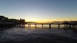 Aerial drone shots of flying through the docks at sunset