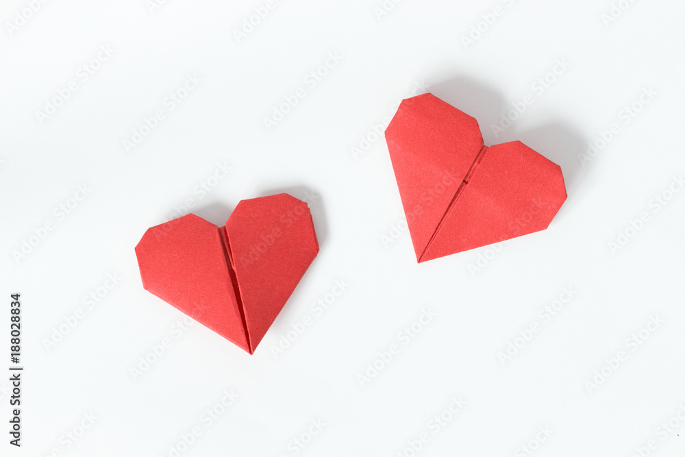 Fototapeta Two red origami hearts on white background. Valentin's Day gift cards. Top view.