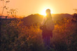 A woman backpacker looking to the sun at Mon jam, Chiangmai, Thailand.