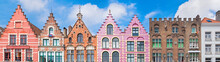 Traditional Colorful Belgian Facades Of Houses At Market Square In City Of Bruges.