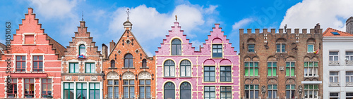 Foto op Aluminium Brugge Traditional colorful Belgian facades of houses at Market square in city of Bruges.