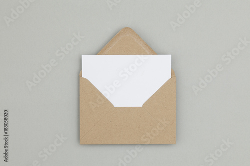 Obraz Blank white card with kraft brown paper envelope template mock up - fototapety do salonu
