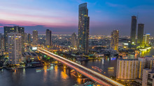 Aerial View Of River With Saphan Taksin Bridge In Bangkok.Thailand