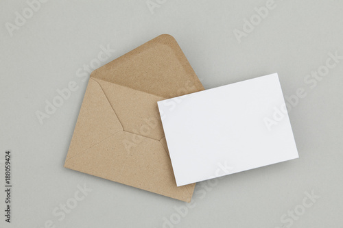 Valokuva  Blank white card with kraft brown paper envelope template mock up