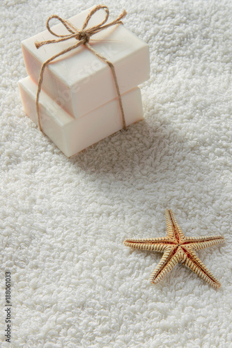 Fotografie, Obraz  Two gift soap bar on white towel with space for text