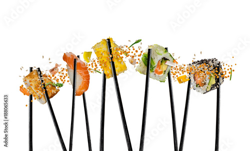 Fotografía  Pieces of sushi with wooden chopsticks, separated on white background