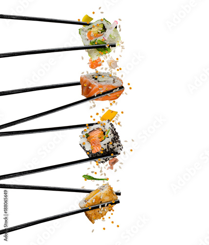 Pieces of sushi with wooden chopsticks, separated on white background.