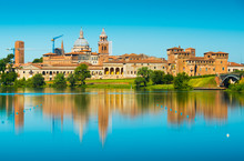 Cityscape Reflected In Water. Mantova, Lombardy, Italy