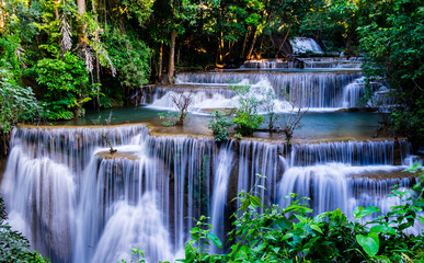 Fototapeta Waterfall in tropical forest at Huay Mae Khamin National Park, Thailand