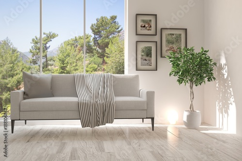 Poster Taupe Idea of white room with sofa and summer landscape in window. Scandinavian interior design. 3D illustration