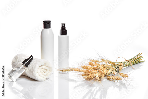 Keuken foto achterwand Spa Herbal and mineral skincare. Jar of cream, oil with wheat, white cosmetic bottles. Without label