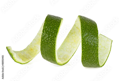 Peel of lime over white background, closeup
