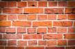 Eine alte Ziegelsteinmauer