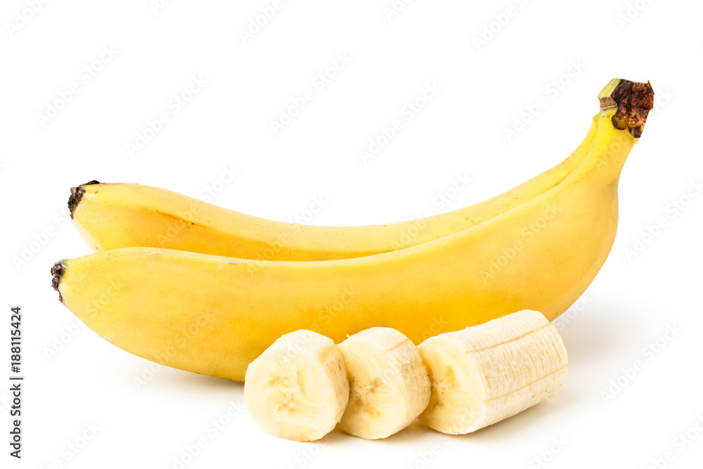 Fotografie, Obraz Two ripe bananas, and cut a piece of peeled banana on a white, isolated