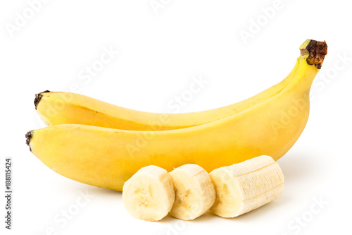Valokuva Two ripe bananas, and cut a piece of peeled banana on a white, isolated