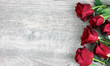 canvas print picture - Beautiful Red Roses Still Life Over Rustic Wooden Background, Love Concept, Shot From Above